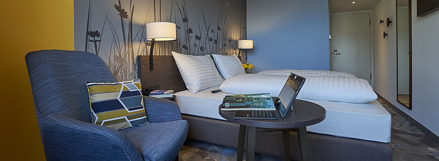 Frische Farben und lässiger Stil: Die Zimmer im 4Rest Hotel Hall.