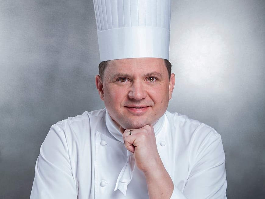 Franck Giovannini mit Kochhaube