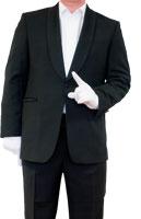ein Mann deutet mit dem im weissen Handschuh steckendem Zeigefinger nach Oben um die Geste einer Aufforderung nachzuahmen