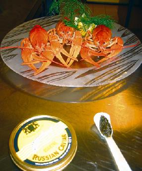 Flusskrebse mit Sellerie ravioli und beluga kaviar